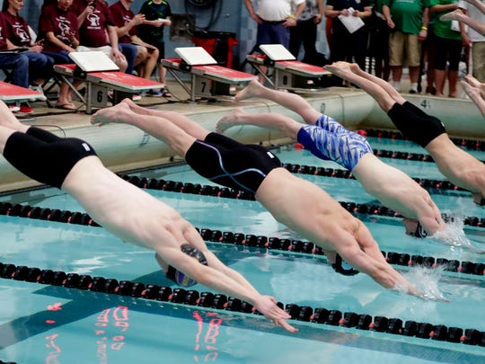 From left, Lucas Koepke, Elkhorn; and Max McHugh, Sturgeon Bay, dive from the platform in the 50 yard freestyle.