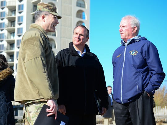 Col. Edward Chamberlayne, U.S. Army Corps of Engineers, Maryland Secretary of Natural Resources Mark Belton and Ocean City Mayor Rick Meehan speak about the beach renourishment project on Monday, Nov. 20, 2017.