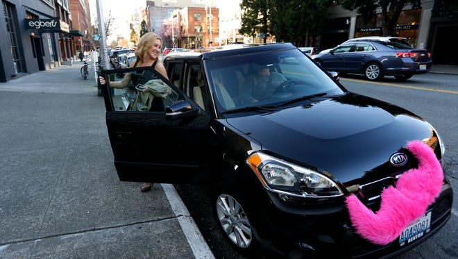 Lyft drivers use cars that display a pink moustache on the front grill.