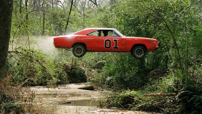 The car (The General Lee) in  scene 'The Dukes of Hazzard.'