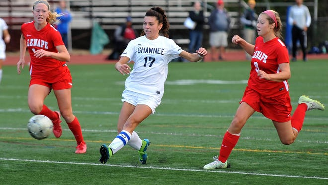 Shawnee's Alexis Palladino (17) scores with this touch, flanked by Lenape's Megan Quimby (left) and Kasey Donoghue (right), Sunday, Oct. 25 in Haddonfield.