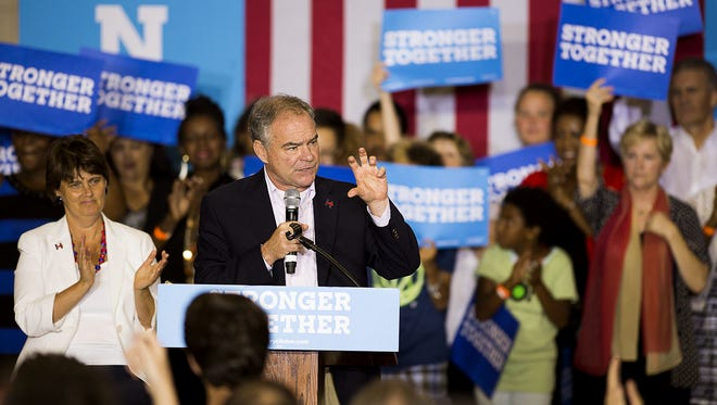 Democratic vice presidential candidate Tim Kaine speaks Aug. 15 in Asheville as his wife, Anne Holton, applauds just behind him. Kaine is making a return visit to the area next week.
