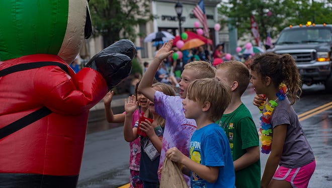 Kids were excited to high-five the Jets Pizza mascot during last year's Founders Festival parade.