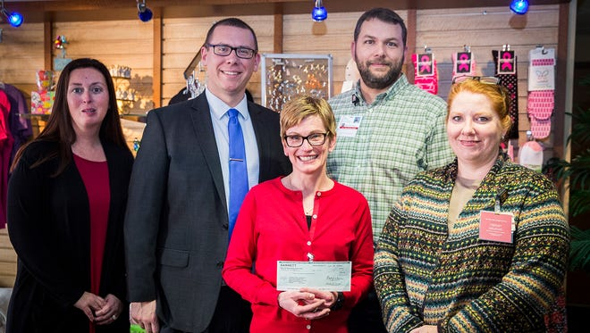 The Star Press presented the Cancer Center Boutique with a check representing funds raised through Wine, Dine & Unwind 2017 at IU Health Ball Memorial Hospital Wednesday afternoon. Pictured left to right: From The Star Press, Mary Vannatta and Greg Fallon, and from the hospital, IUHBMH Foundation President Tricia Stanley, IUHBMH CFO Jon Vanator and Mary Whitenack, Cancer Center Boutique manager.