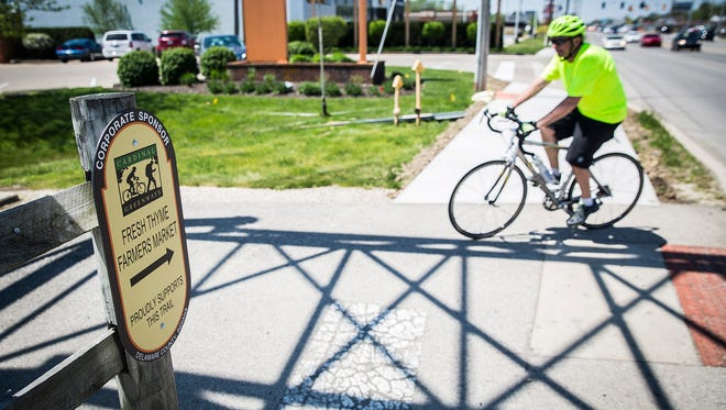 Construction of a bike-friendly sidewalk that extends from the Cardinal Greenway to Starbucks and the Fresh Thyme grocery store on McGalliard Road was completed this week.