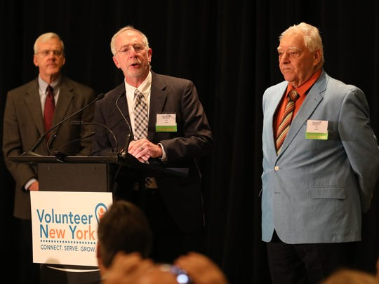 Paul Alcorn, center, and Mel Berger, right, with The Emergency Shelter Partnership, won the Safe Community Award during the 38th Annual Volunteer Spirit Awards presented by Regeneron and Volunteer New York, at the Westchester Marriott in Tarrytown, April 20, 2018.