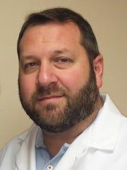 Dr. Aaron Ellenbogan