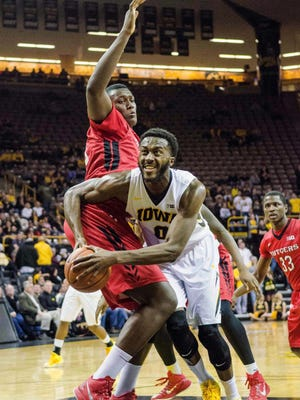 Iowa's Gabe Olaseni drives to the hoop during last Thursday's 81-47 win over Rutgers. The Thursday night game had many empty seats, as there were only 6,907 ticket scans among a paid attendance of 12,594.