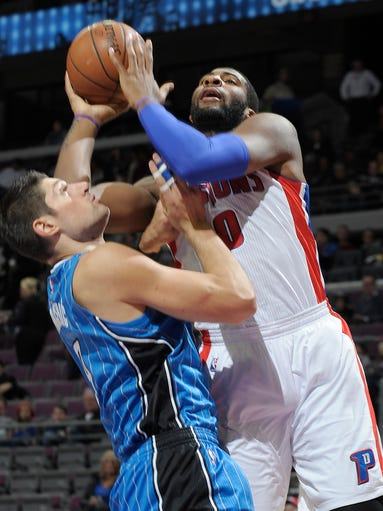 Magic center Nikola Vucevic fouls Pistons center Andre