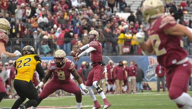 Florida State Seminoles quarterback James Blackman (1) looks to pass the ball to tight end Ryan Izzo (81) against the Southern Miss Golden Eagles during the first half in the 2017 Independence Bowl at Independence Stadium.
