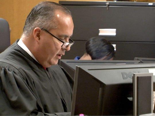 Superior Court Judge Pedro Jimenez presides over the