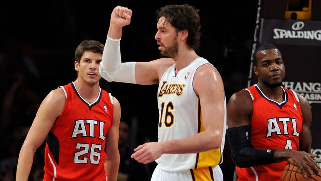 Lakers power forward Pau Gasol pumps his fist after scoring an getting fouled in the first quarter against the Hawks at Staples Center.