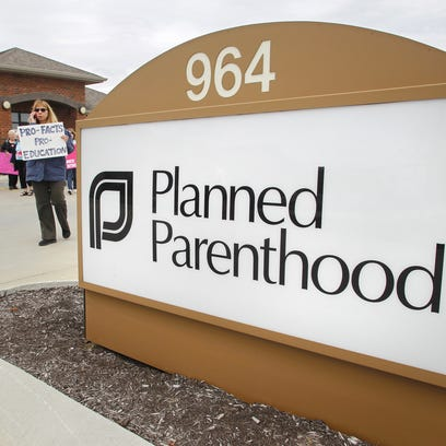 Supporters of Planned Parenthood rallied outside a