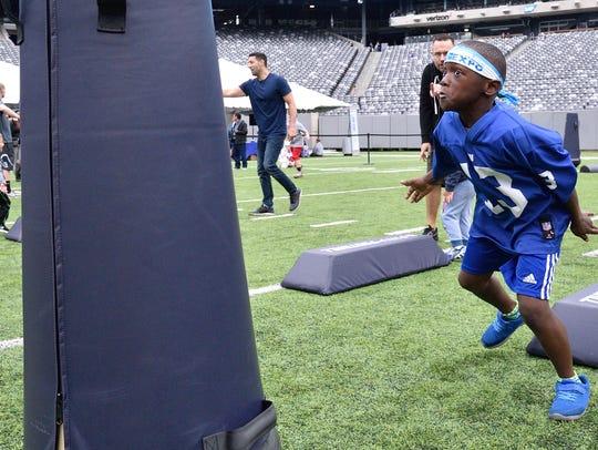 Jaden Francis,9, of Plainfield rushes toward a tackling