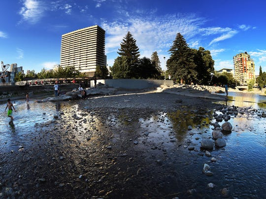 The Truckee River flows towards downtown Reno on June 17, 2015.