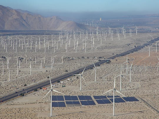 Wind turbines and solar panels dominate the landscape along Interstate 10 near Palm Springs on Oct. 21, 2014.