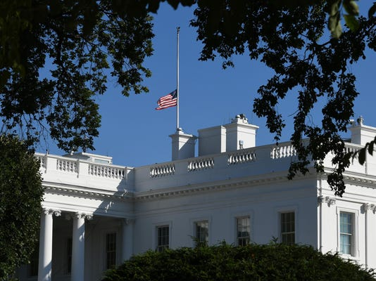 The U.S. flag flies at half-staff over the White House for the victims of the Las Vegas shooting - DC