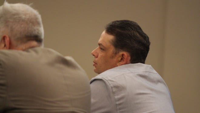 Michael Proctor listens to closing arguments Thursday morning.