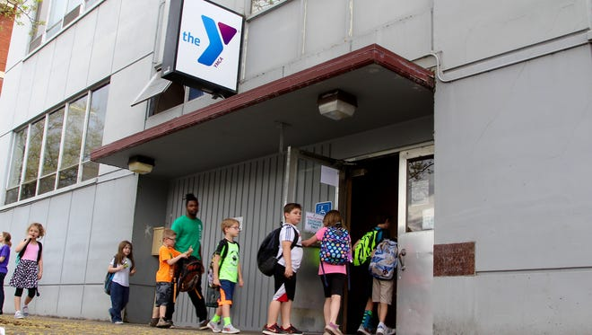Children file into the Family YMCA of Marion & Polk Counties on Thursday, May 4, 2017.