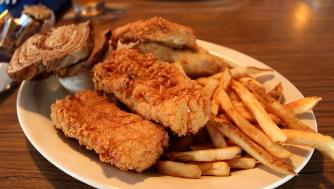 "The cod plate at Crawfish Junction in Milford is one of the dishes served up in Ron Faiola's new documentary ""We're Here for a Fish Fry!"""