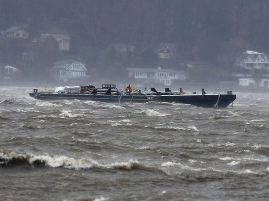 One of two barges spotted floating downriver in the Hudson, as seen from Irvington, south of the Gov. Mario Cuomo Bridge, on Friday afternoon, March 2, 2018. The barges broke free during a powerful nor'easter that brought rain, snow and severe wind to much of the Mid-Atlantic and Northeast.