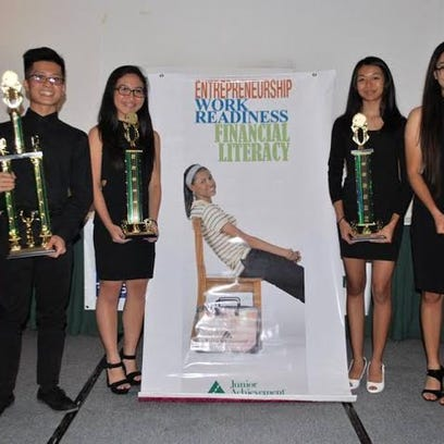 FAIM, sponsored by Tan Holdings Corp., won first place in the Junior Achievement of Guam's Company Program with their lunch pail that transforms into a place mat. Courtesy of Kristina Catague