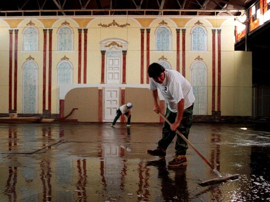 """William Poteete cleans the floor Oct. 14, 1998 for the upcoming Heritage Ball at The Factory. This year's theme is """"An Evening at the Winter Palace."""""""