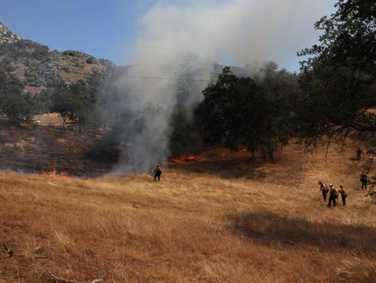 Fire crew members work the Ash Mountain prescribed