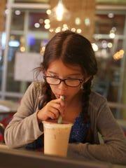 Ashley Barnes, 9, of Bristol, Connecticut, tries  bubble