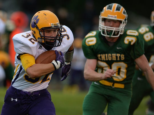 Hagerstown's Clayton Barber runs the ball against Northeastern's