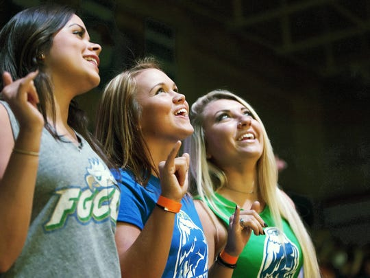 FGCU students spot themselves on Alico Arena's new videoboard Wednesday at the Eagle Revolution pep rally at FGCU in Fort Myers.