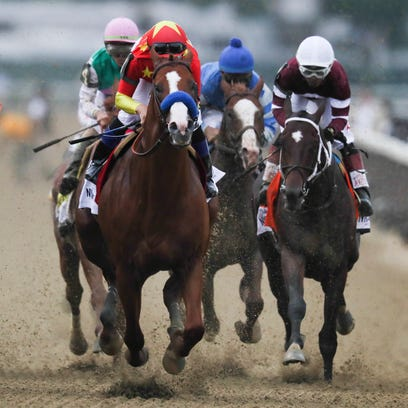 Justify with jockey Mike Smith wins the Belmont Stakes