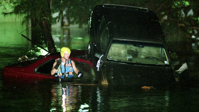 Photos from the Coloradoan archives show rescuers responding to the Spring Creek Flood on July 28, 1997.