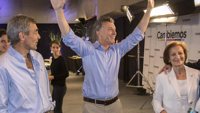 Photo released by Cambiemos press office of supporters of the Head of Government of the Autonomous City of Buenos Aires and candidate for the Cambiemos (Let's Change) party, Mauricio Macri (C), celebrating at the Cambiemos (Let's Change) party headquarters in Buenos Aires on November 22, 2015, after getting the first results of the presidential run-off election in Argentina. Pro-market leader Macri, won Argentina's presidential run-off vote against Buenos Aires province governor and presidential candidate for the Frente Para la Victoria (Front for Victory) Daniel Scioli on Sunday, early official results showed, breaking with 12 years of leftist rule in Latin America's third-biggest economy. AFP PHOTO/ Cambiemos - Juan Marcelo BaiardiHO/AFP/Getty Images