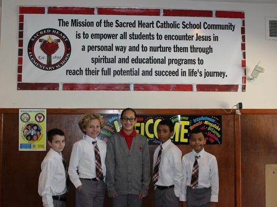 Sacred Heart School students Lorenzo Perez, Madison Lopez, Kalel Colon, Patrick Berry-Lozado, and Ryan Giermanski were chosen to have their Catholic Schools Week poster displayed at the State House in Trenton earlier this winter. The students were asked to design a poster which identifies the spirit of the Catholic School Community and displays the good public works and deeds done in their communities by them, or their families, teachers, other students, neighbors, or friends. The project, Catholic Schools: Communities of Faith, Service and Knowledge Who Do the Public Good, was co-sponsored by the Diocese of Metuchen and the Archdiocese of Newark. Sacred Heart is part of the Raritan Bay Catholic Prepartory School community in South Amboy.