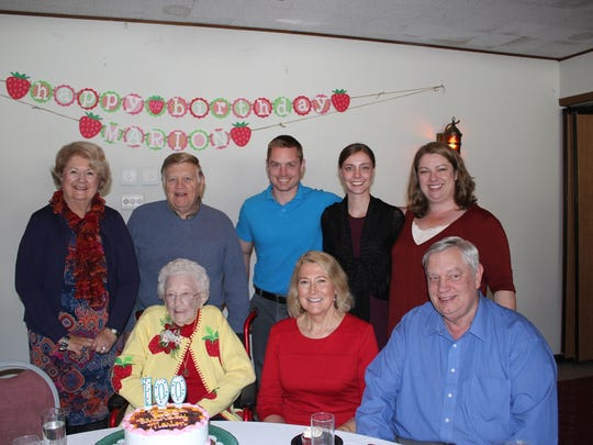 Marion Schlise, lower left, celebrates her 100th birthday with family. Standing from left, Marilynn and Ron Schlise; Sean, Molly and Amanda Fullan. Sitting with her are Sally Schlise and Neil Fullan.