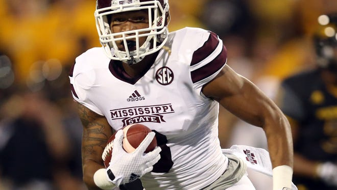 Sep 5, 2015; Hattiesburg, MS, USA; Mississippi State Bulldogs wide receiver Fred Ross (8) runs after a catch in the first quarter of their game against the Southern Miss Golden Eagles at M.M. Roberts Stadium. Mandatory Credit: Chuck Cook-USA TODAY Sports
