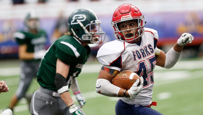 Chenango Forks' Jeremiah Allen carries the ball past Pleasantville's Declan McDermott to score a touchdown during the Class B state championship on Nov. 26 in Syracuse.