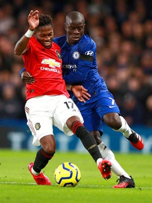 Manchester United's Fred, left, and Chelsea's N'Golo Kante battle for the ball during the English Premier League soccer match between Chelsea and Manchester United at Stamford Bridge in London, England, Monday, Feb. 17, 2020.