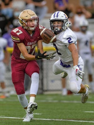 DeSales' Nicky Pentello (right) breaks up a pass intended for Watterson's Brandon Trout during the teams' game Aug. 28 at Watterson. DeSales won 28-22 in overtime.