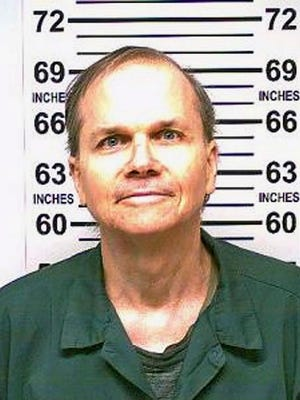 """FILE - This Jan. 31, 2018 photo, provided by the New York State Department of Corrections, shows Mark David Chapman, the man who killed John Lennon outside his Manhattan apartment in 1980. Chapman said he was seeking glory and deserved the death penalty for the """"despicable"""" act. Chapman made the comments in response to questions last month from a parole board, which denied him parole for an 11th time."""