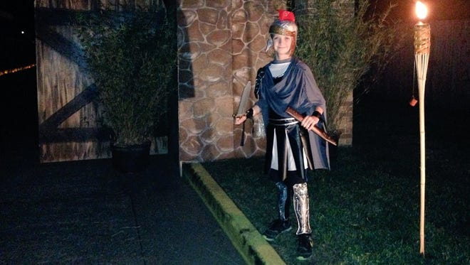 First United Methodist Church of Alexandria member Matt McQuain, 10, stands guard Sunday as a Roman soldier. He was one of the first to greet community members as they entered the church's live nativity event.