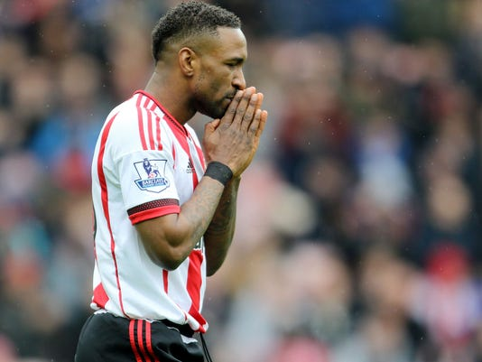 Sunderland's Jermain Defoe gestures, during the English Premier League soccer match between Sunderland and West Bromwich Albion,  at the Stadium of Light, in Sunderland, England, Saturday April 2, 2016. (Richard Sellers/PA via AP) UNITED KINGDOM OUT