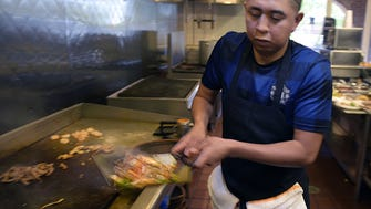 La Hacienda cook Roberto Gustamonte makes fajitas during lunchtime in July 2016.  The Woodbine mexican resturant La Hacienda Tortilleria opened in 1992 on Nolensville Pike as a small market and tortilla factory to serve our growing Hispanic community. It was a first of its kind in Nashville, ushering in generations of markets, taquerias, shops, and mobile taco stands along that busy corridor — and throughout the city.