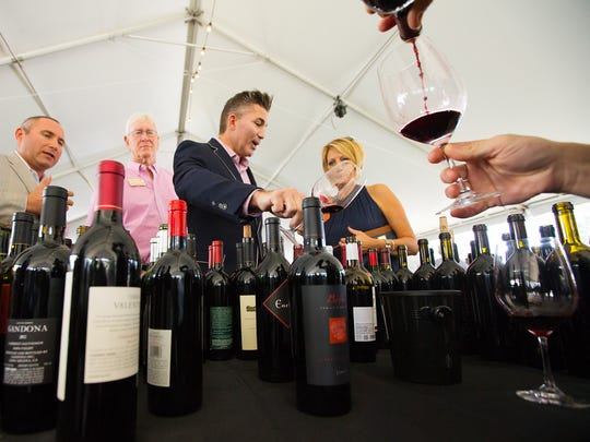 Scenes from the Naples Winter Wine Festival live auction Saturday at the The Ritz-Carlton Golf Resort in Naples.
