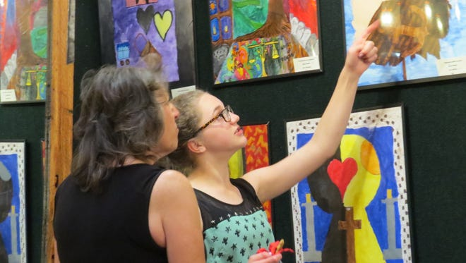 "Sacred Heart Catholic School students in sixth through eighth grades displayed their artwork earlier this month at the ""Symbolic Sojourns"" exhibit at Artifacts Gallery in Farmington."
