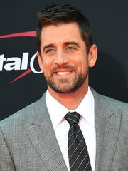 Green Bay Packers quarterback Aaron Rodgers arrives