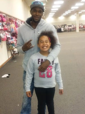 """Allen """"Ace"""" Melton and his 8-year-old daughter, Nina."""