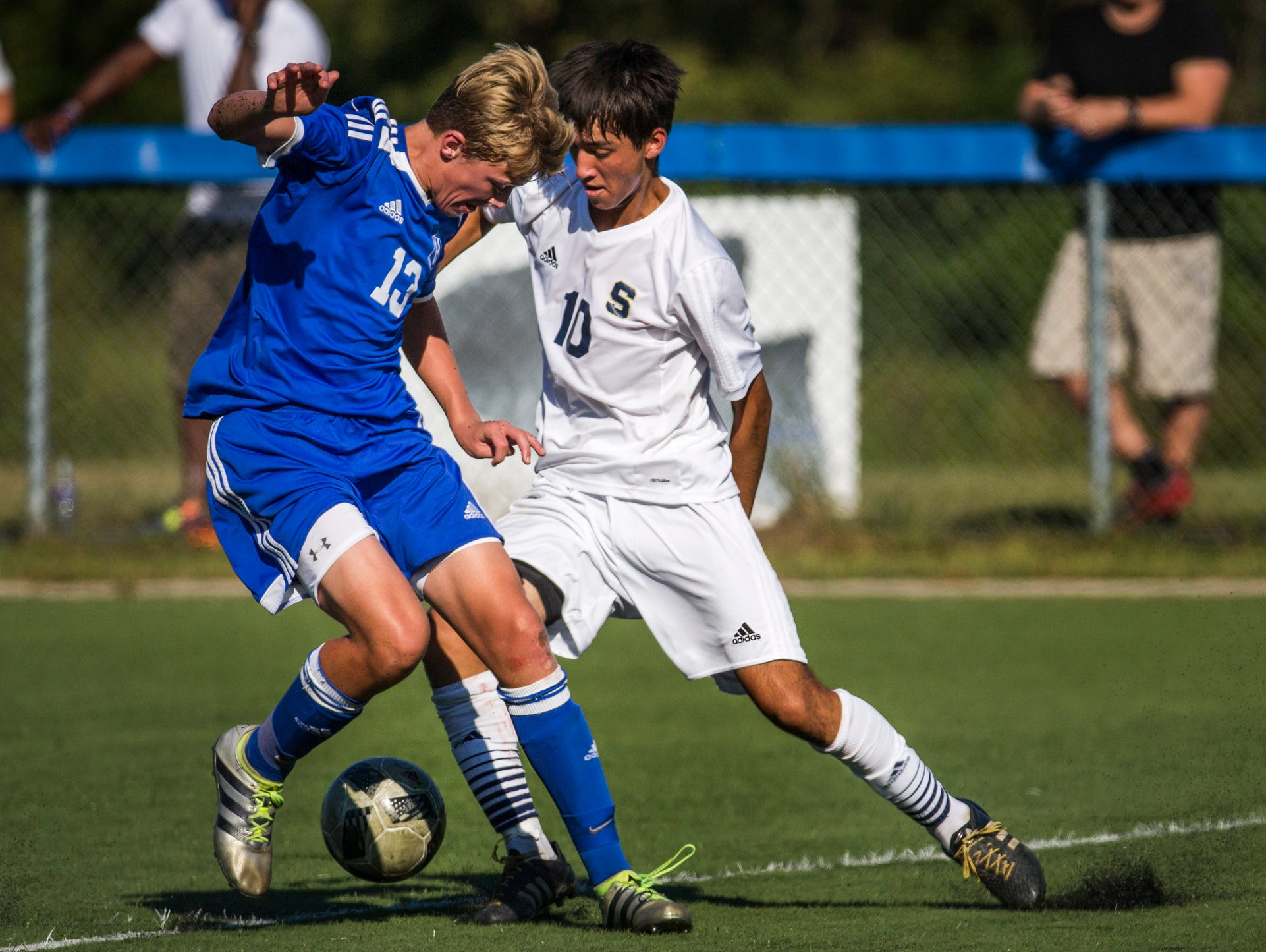 Salesianum's Gavin Ford (No. 10) cuts behind Wilmington Charter's Graeme Newcombe (No. 13) as he positions himself for a shot on goal in the first half of Salesianum's 1-0 win over Wilmington Charter at the Hockessin Soccer Club in Hockessin on Thursday afternoon. Ford scored the only goal of the game on the play.