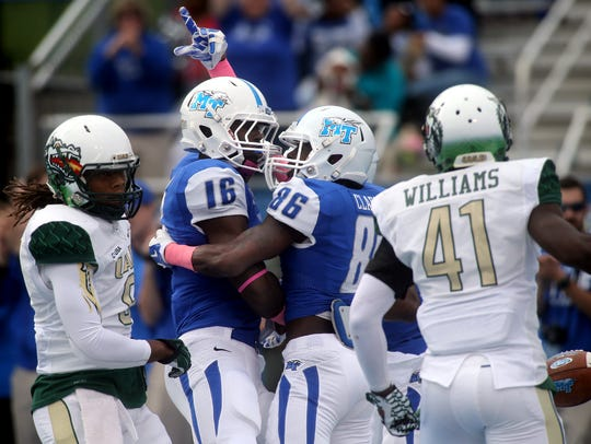 MTSU's Chris Perkins and terammate Devin Clark celebrate